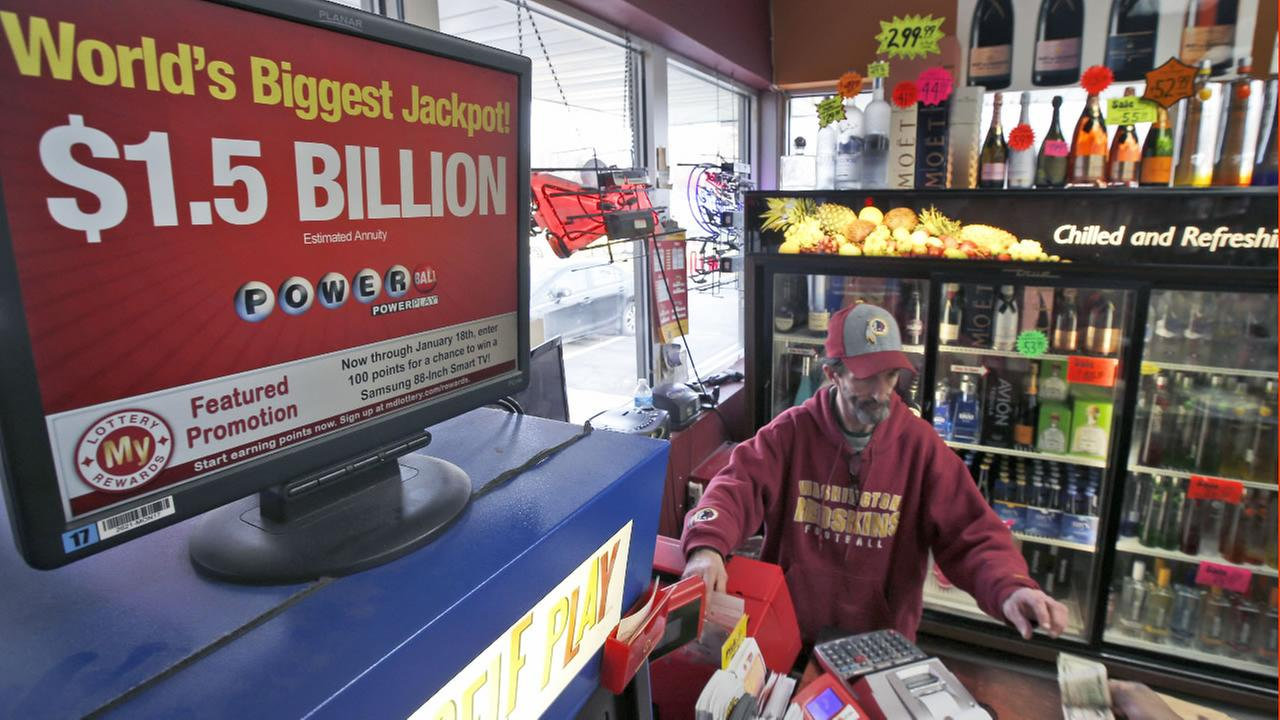 Steve Poulin sells Powerball tickets at the Sunnybrook Tavern and Liquor Store, Wednesday, Jan. 13, 2016 in Fort Washington, Md.