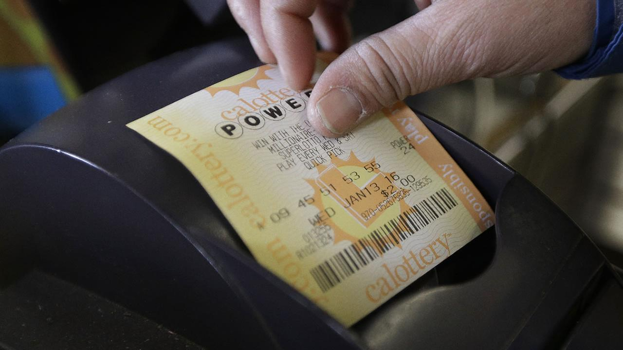 A store clerk removes a Powerball quick pick lottery ticket Wednesday, Jan. 13, 2016, in Oakland, Calif. The Powerball jackpot has grown to over $1 billion dollars.