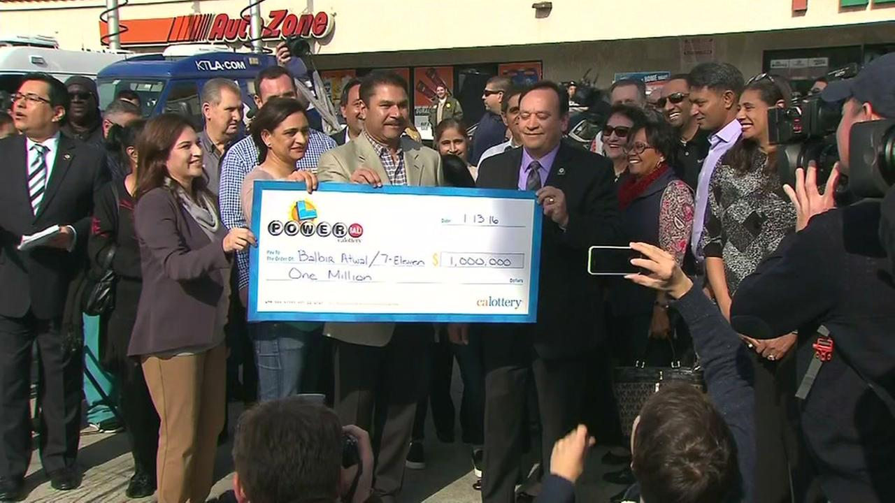 A $1 million check was given to Balbir Atwal who was the store owner where a winning Powerball ticket was sold, Thursday, January 14, 2016.