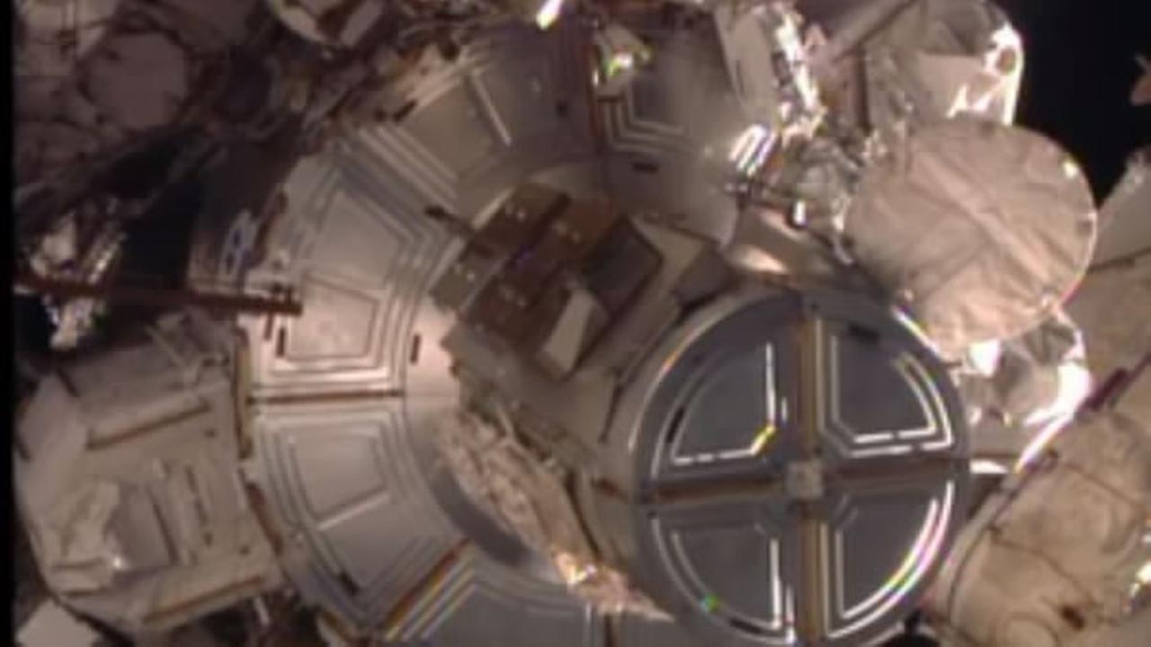 Two astronauts - including Britains first spacewalker - are work to restore full power to the International Space Station on Friday, January 15, 2016.