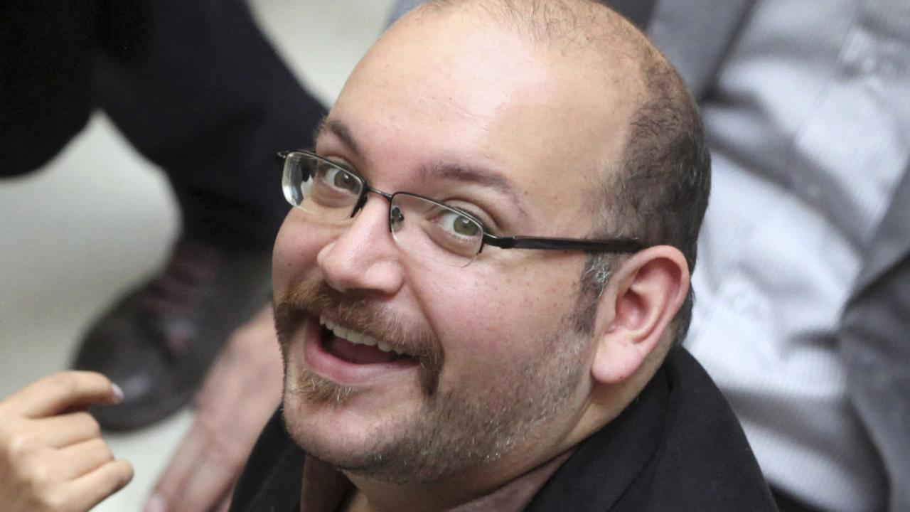In this photo April 11, 2013 file photo, Jason Rezaian, an Iranian-American correspondent for The Washington Post, attends a presidential campaign of President Rouhani in Tehran.