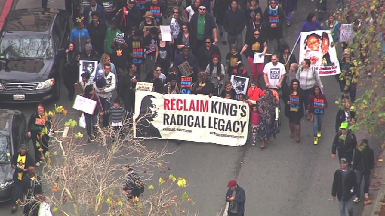 Activists march through Oakland, Calif., on Monday, January 18, 2016, for the 96 Hours of Direct Action to Reclaim Kings Radical Legacy part of the Reclaim MLK Weekend.
