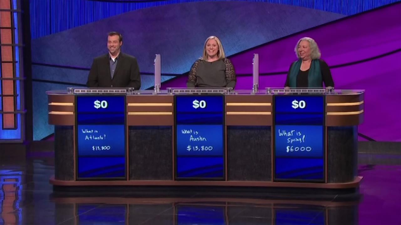 This image shows contestants on Jeopardy! January 18, 2015 after no one took home any money.