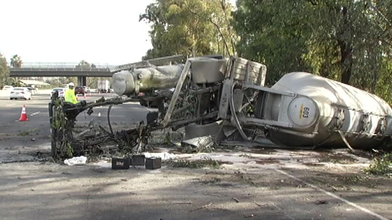 A big-rig he collided with a stolen sedan and overturned on U.S. Highway 101 in San Jose, Calif. Jan. 20, 2016.