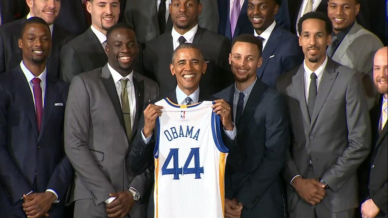 President Barack Obama holds up a Golden State Warriors jersey after honoring the team at White House in Washington D.C. on Thursday, February 4, 2016.