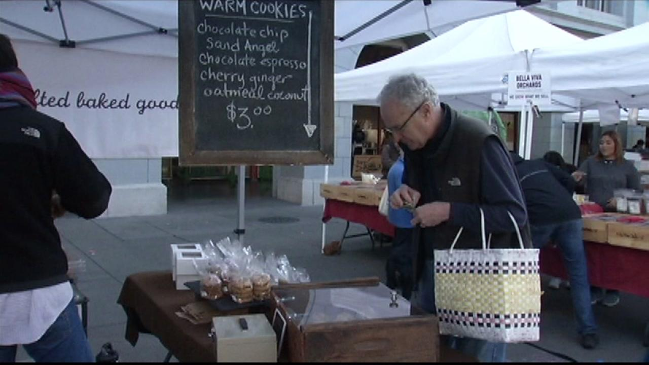 A man shops at the farmers market at the Ferry Building in San Francisco, Calif. on Saturday, February 6, 2016.