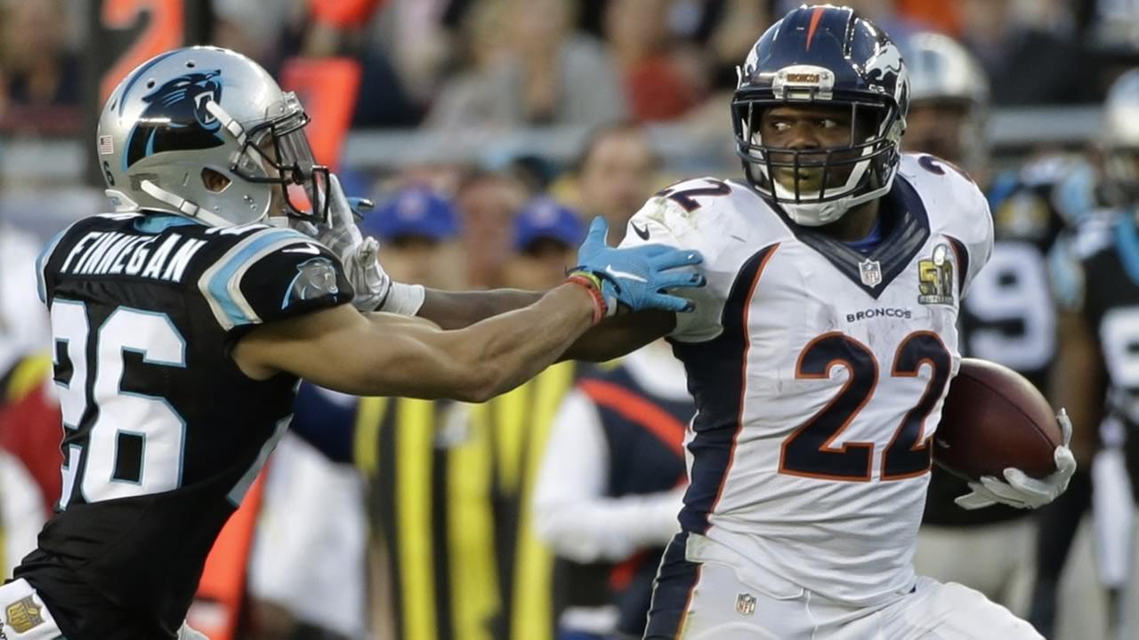 Denver Broncos C.J. Anderson (22) pushes off Carolina Panthers Cortland Finnegan (26) during the first half of Super Bowl 50 on Sunday, Feb. 7, 2016, in Santa Clara, Calif. (AP Photo/Jae C. Hong)