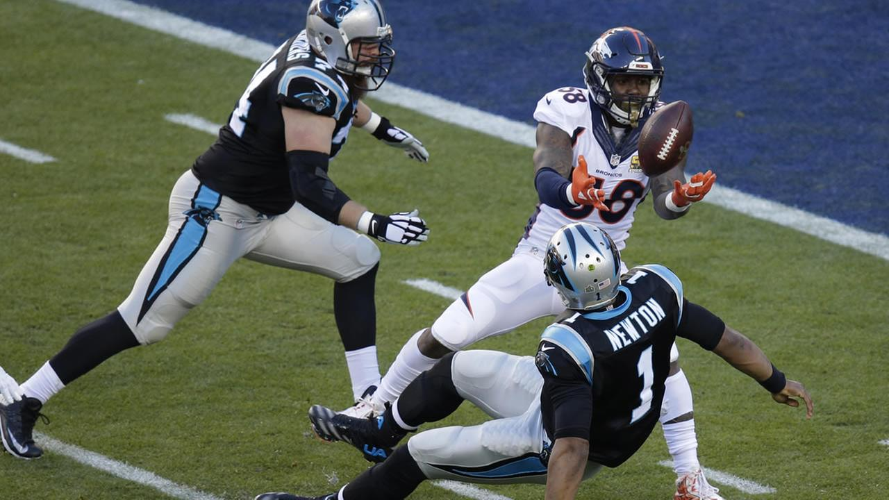 Denver Broncos Von Miller (58) strips the ball from Carolina Panthers Cam Newton (1) during the first half of Super Bowl 50 on Sunday, Feb. 7, 2016, in Santa Clara, Calif. (AP Photo/Charlie Riedel)