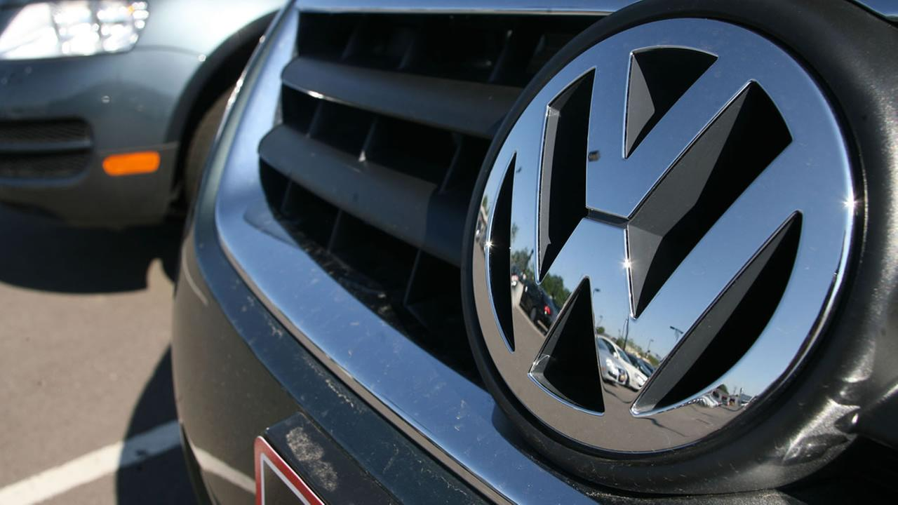 FILE - In this Wednesday, July 26, 2006, file photo, a Volkswagen reflects a Volkswagen dealership in the west Denver suburb of Lakewood, Colo. U.S. (AP Photo/David Zalubowski)