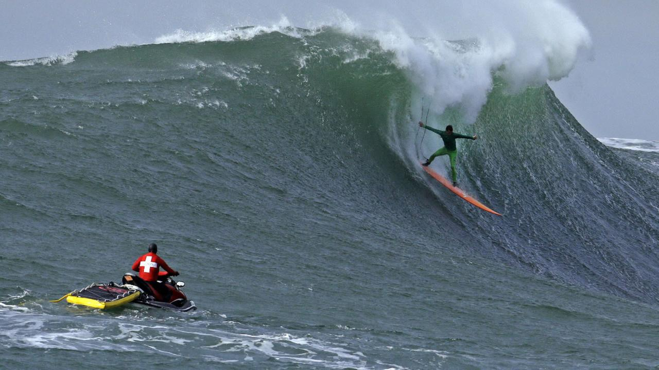 Nic Lamb surfs a giant wave during the finals of the Mavericks surfing contest Friday, Feb. 12, 2016, in Half Moon Bay, Calif. Lamb won the event.