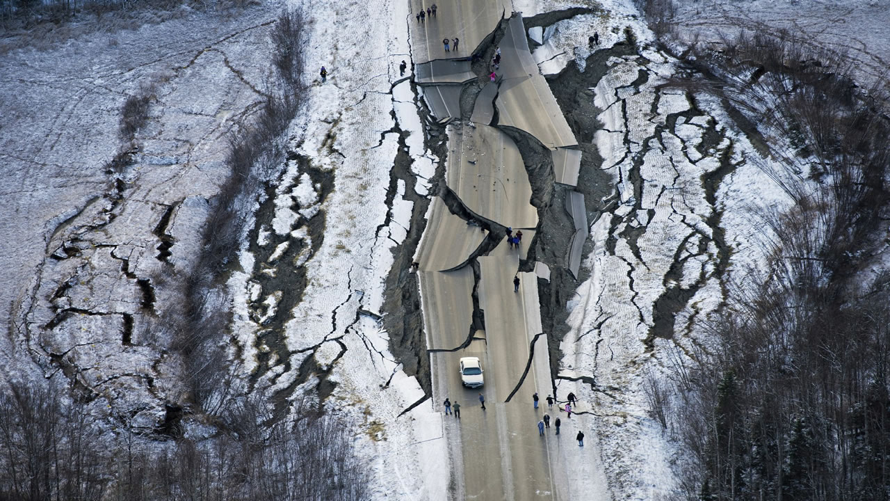 This aerial photo shows damage on Vine Road, south of Wasilla, Alaska after earthquakes Friday.