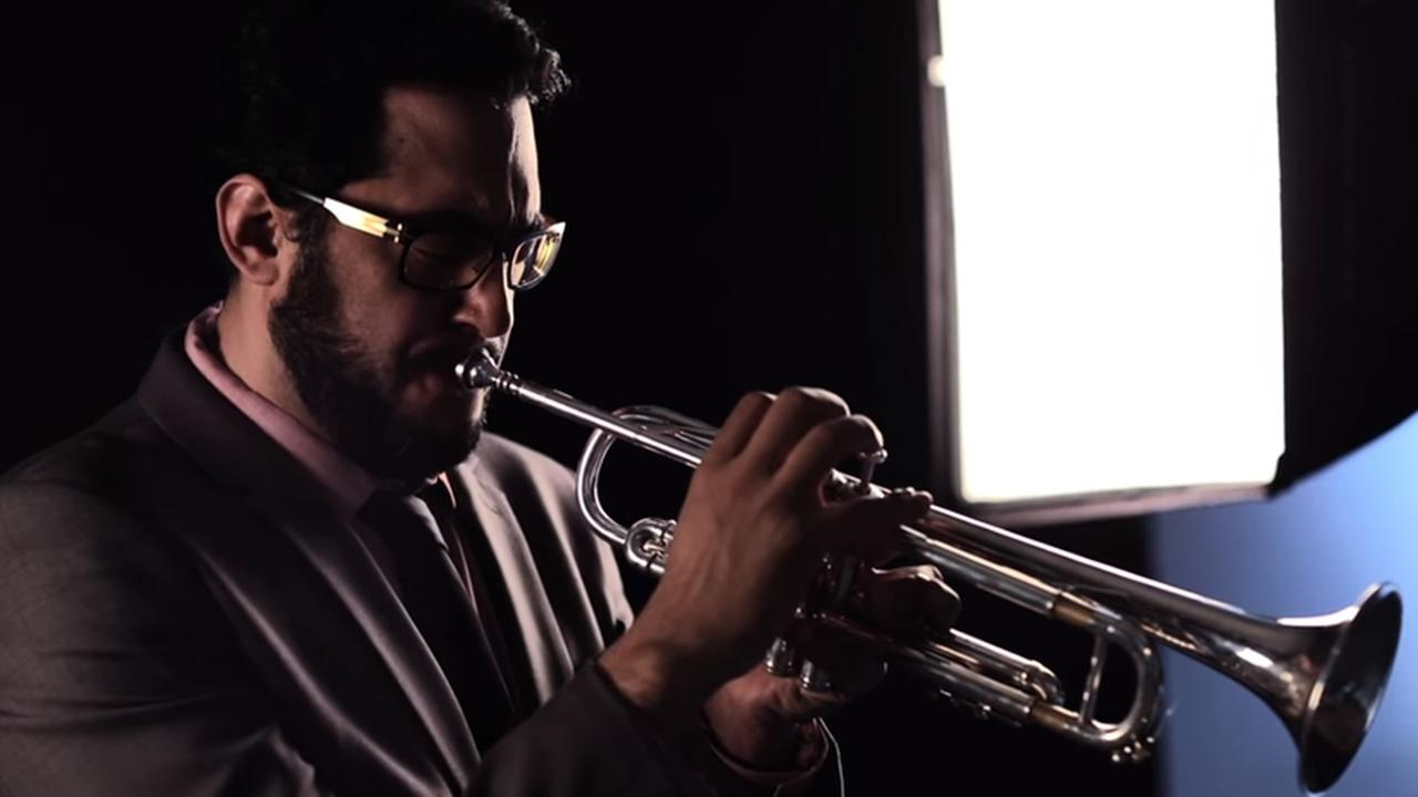 This undated image shows California State East Bay grad student Mario Silva playing the trumpet.