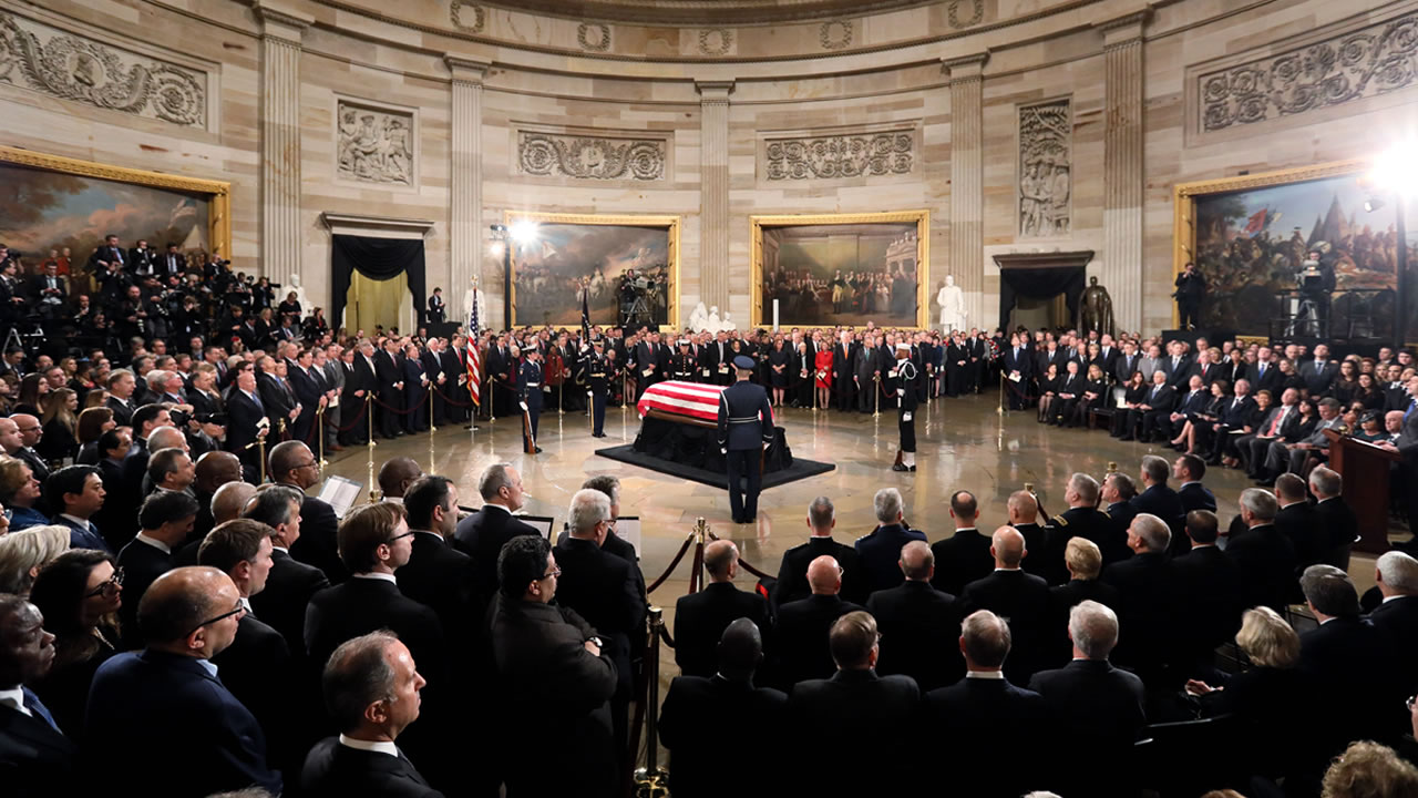 The flag-draped casket of former President George H.W. Bush lies in state in the Capitol Rotunda in Washington, Monday, Dec. 3, 2018.