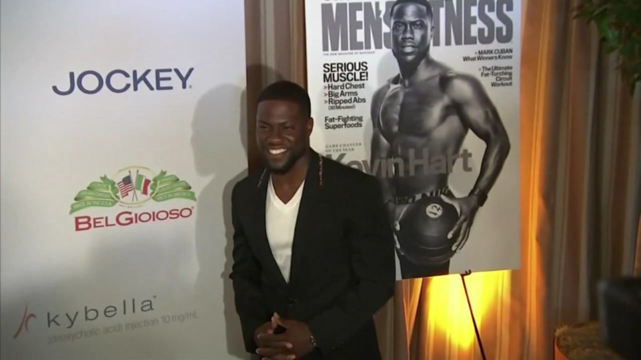 Kevin Hart posing in front of cameras on an unknown date.