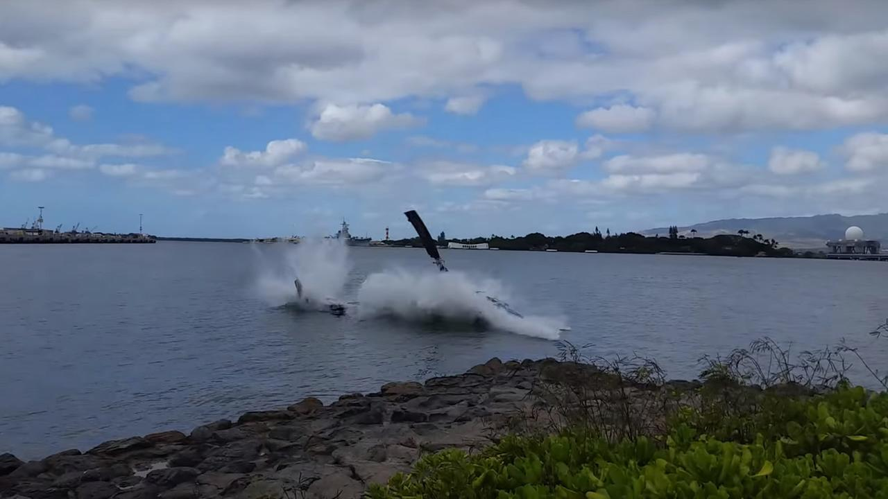 Authorities in Hawaii say a civilian helicopter made a hard landing in the water near Pearl Harbor on Thursday, February 18, 2016.