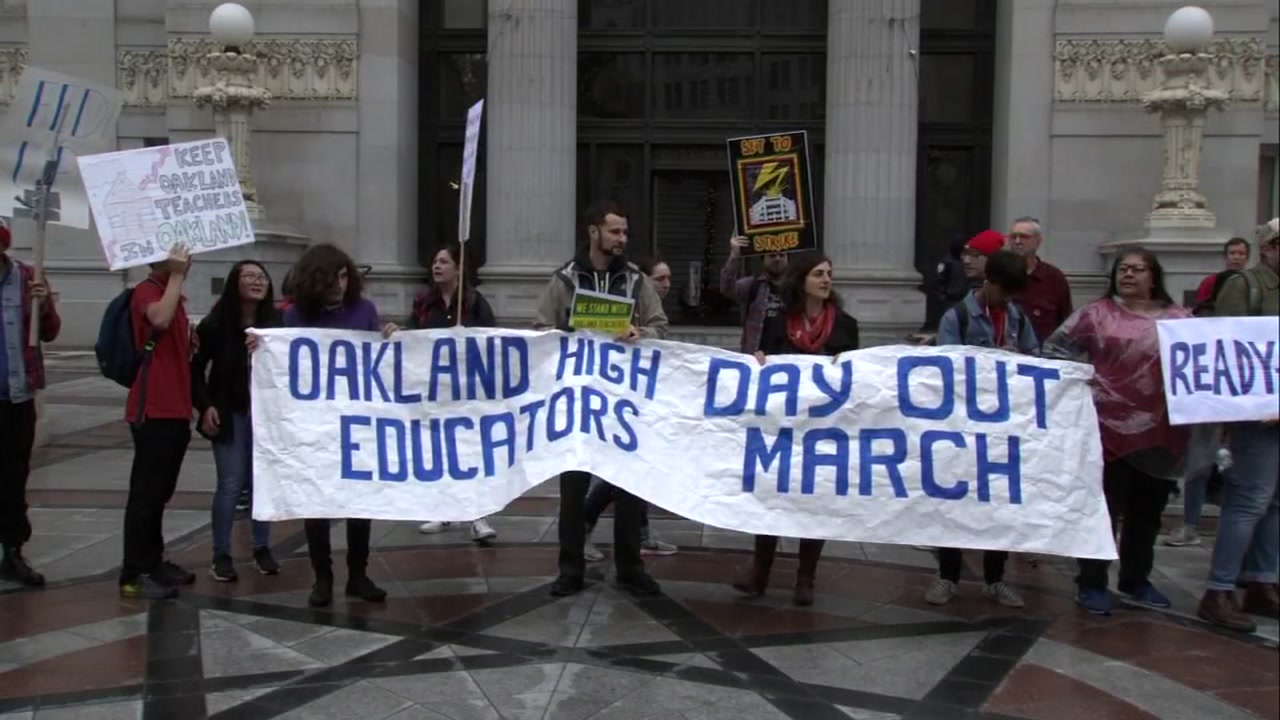 Oakland teachers protest stalled talks with the school district over their demands for pay raises on Monday, Dec. 10, 2018 in Oakland, Calif.
