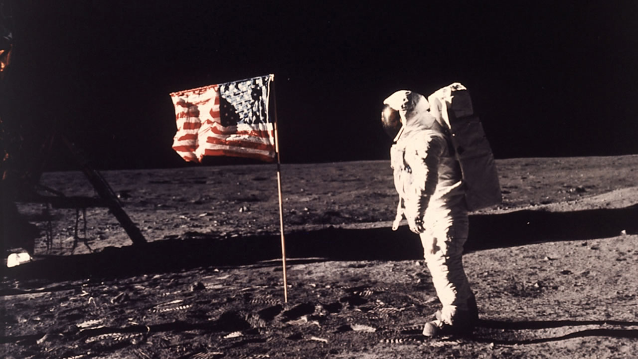 Astronaut Edwin E. Buzz Aldrin Jr. poses for a photograph beside the U.S. flag deployed on the moon during the Apollo 11 mission on July 20, 1969.