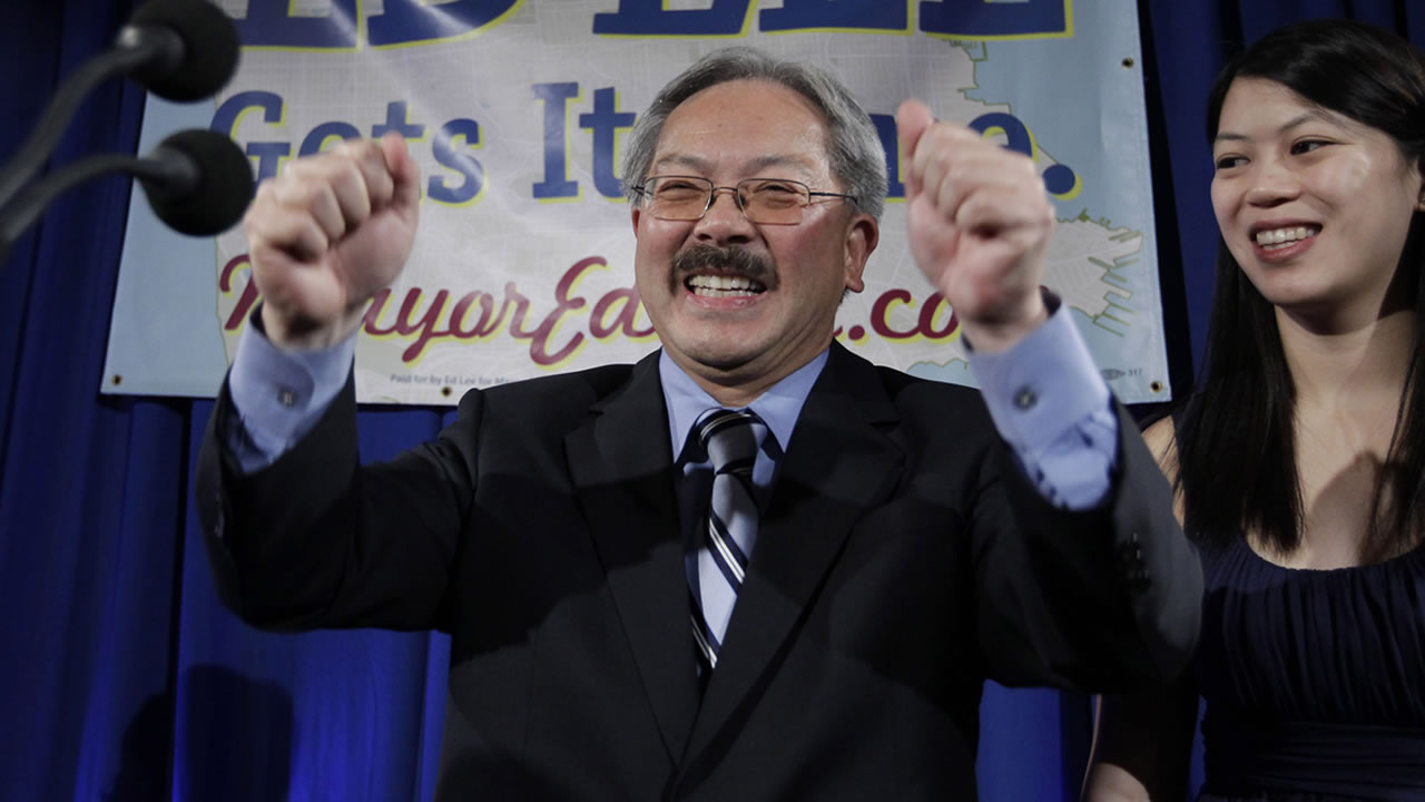 San Francisco mayor Ed Lee smiles as his daughter, Brianna, right, looks on at his campaign headquarters for mayor in San Francisco, Tuesday, Nov. 8, 2011, after the polls closed.