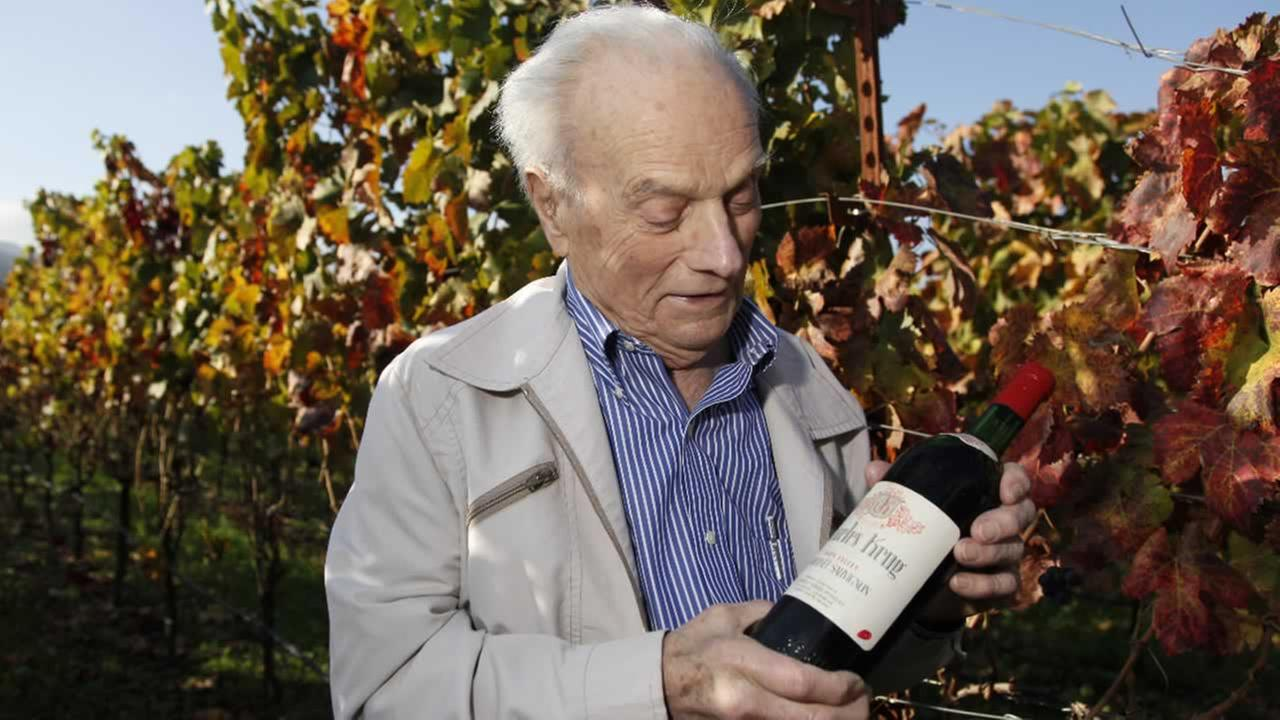 This photo taken Nov. 4, 2009 shows Peter Mondavi Sr. looking at a bottle of 1944 Charles Krug Cabernet Sauvignon, the first his family produced in St. Helena, Calif.
