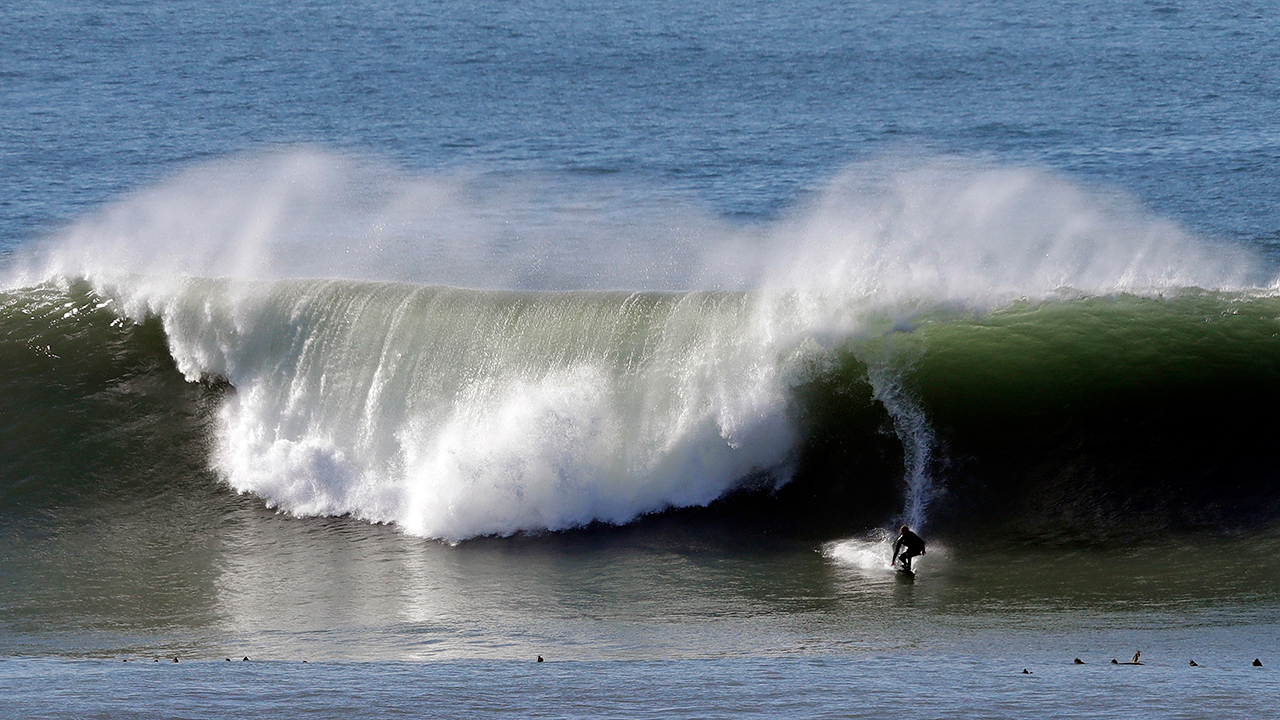 A surfer tackles a wave at the Mavericks surf spot off Pillar Point Harbor Friday, Jan. 27, 2017, in Half Moon Bay, Calif.