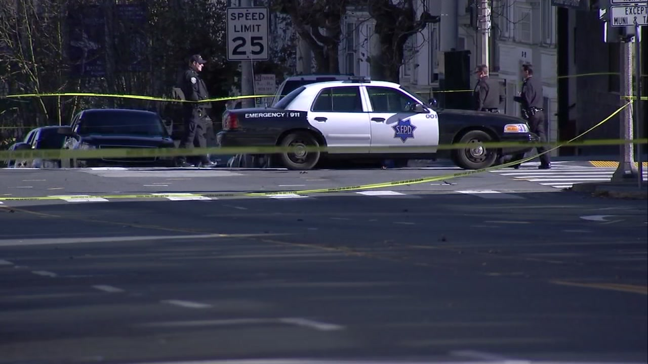 A web of crime scene tap lines the streets in San Francisco after several bomb threats were made.