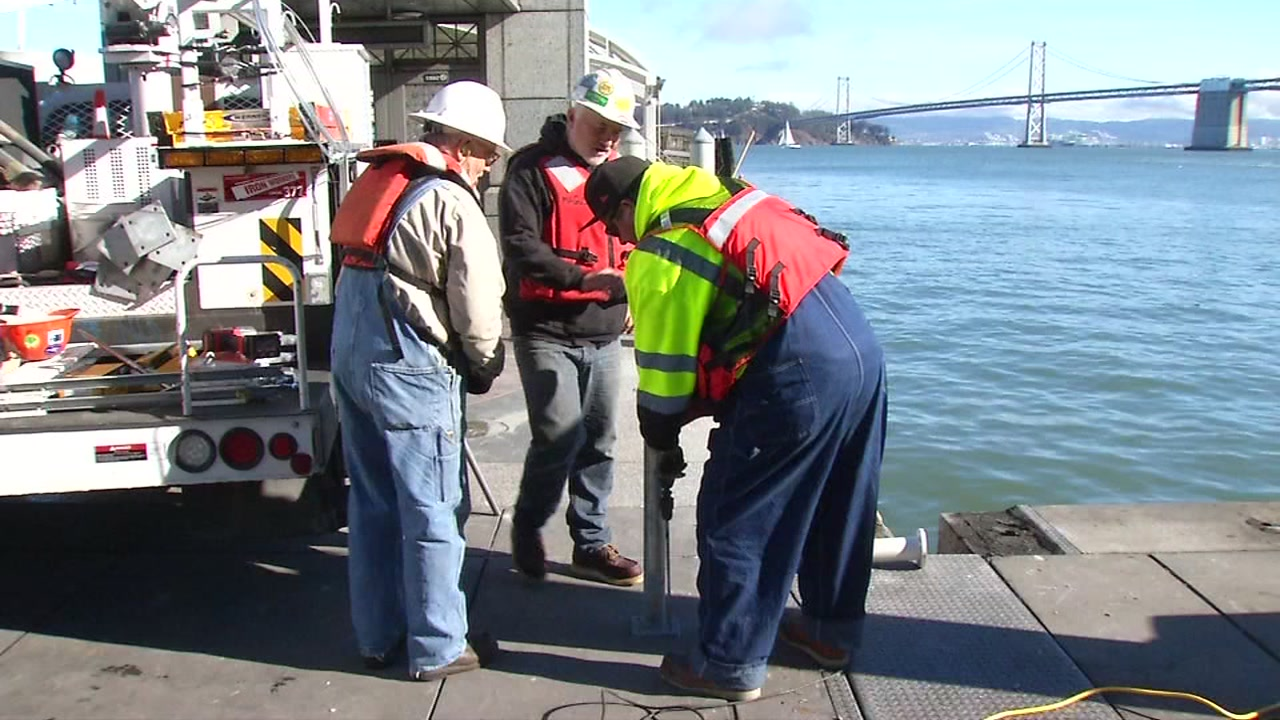 Workers fixing damage at a San Francisco dock after a ferry crashed into it in November.