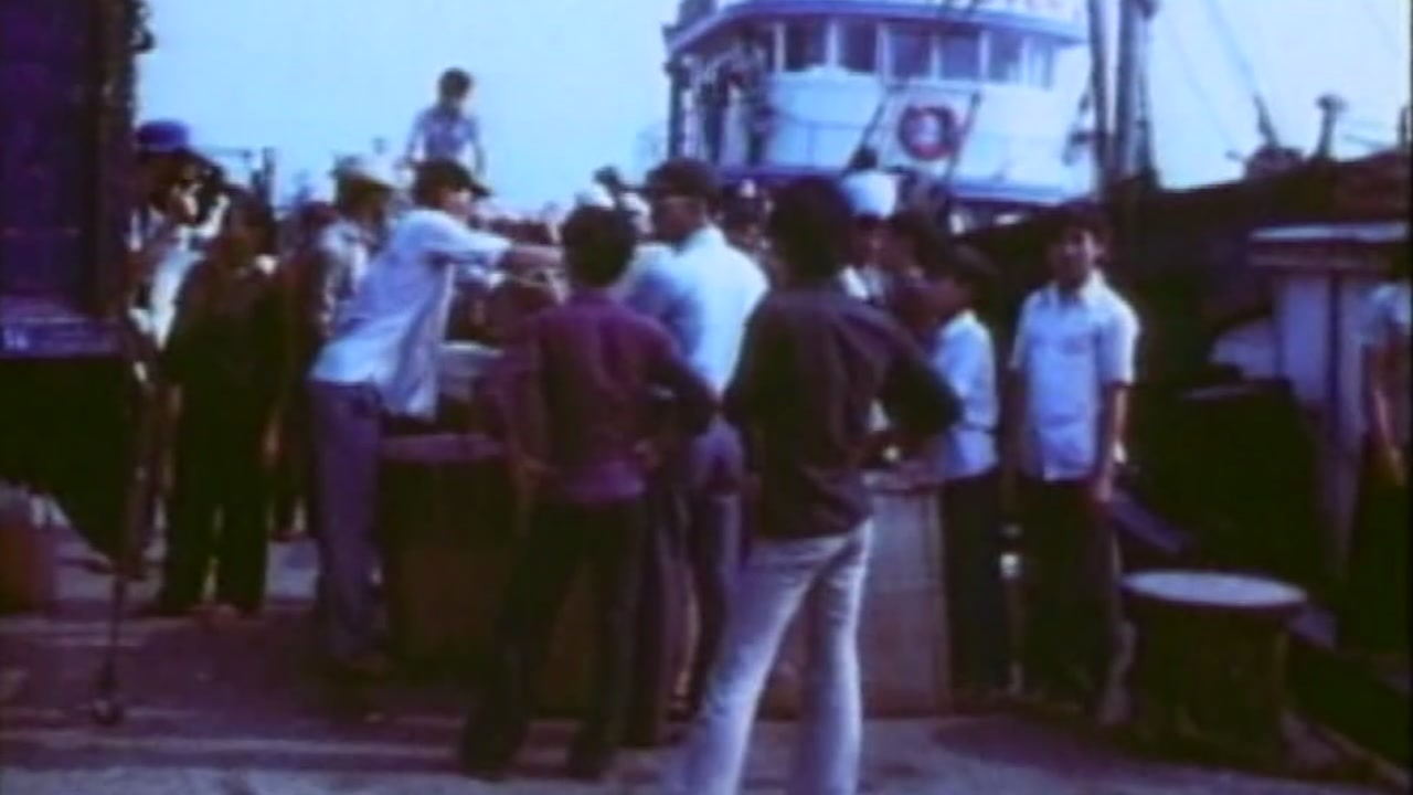 Stock footage of Vietnam refugees.