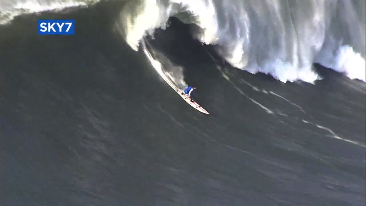 Surfer takes on monster wave at Mavericks in Half Moon Bay.