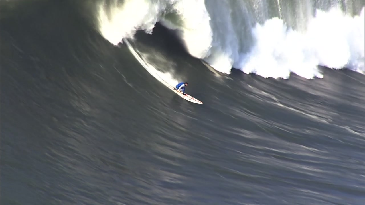 Surfer riding huge wave at Mavericks in Half Moon Bay.