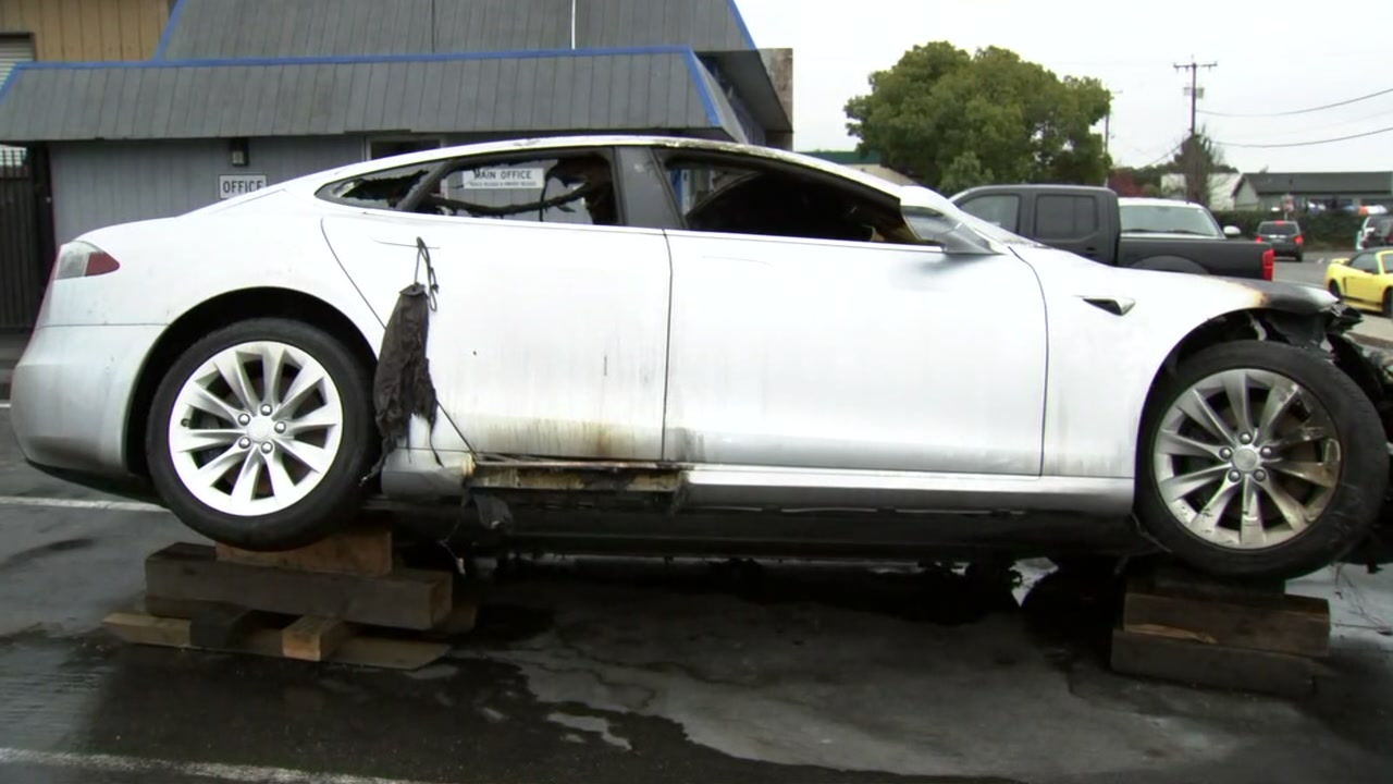 Tesla vehicle that caught fire sits at an auto shop in Campbell, California on Wednesday, December 19, 2018.