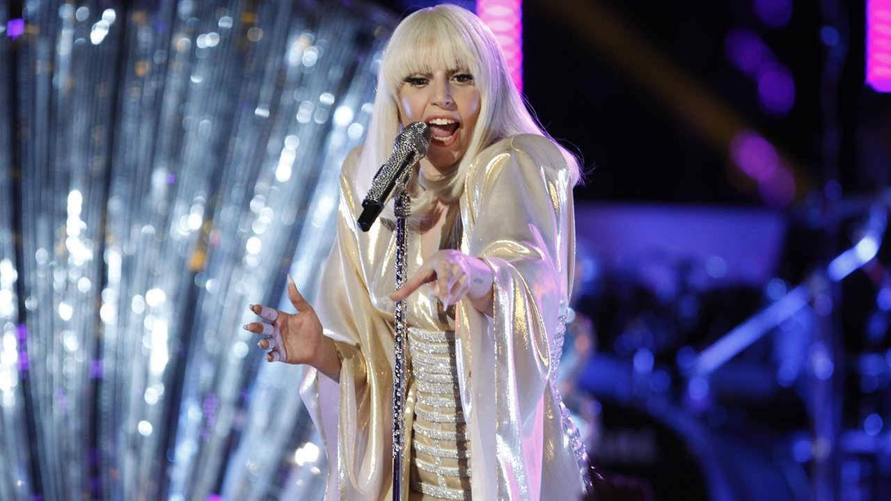 In this Dec. 17, 2013 file photo provided by NBC, Lady Gaga performs during the season five finale of The Voice in Los Angeles. (AP Photo/NBC, Trae Patton, File)