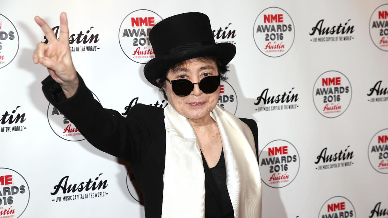 Yoko Ono poses for photographers upon arrival at the NME 2016 music awards in London, Wednesday, Feb. 17, 2016.