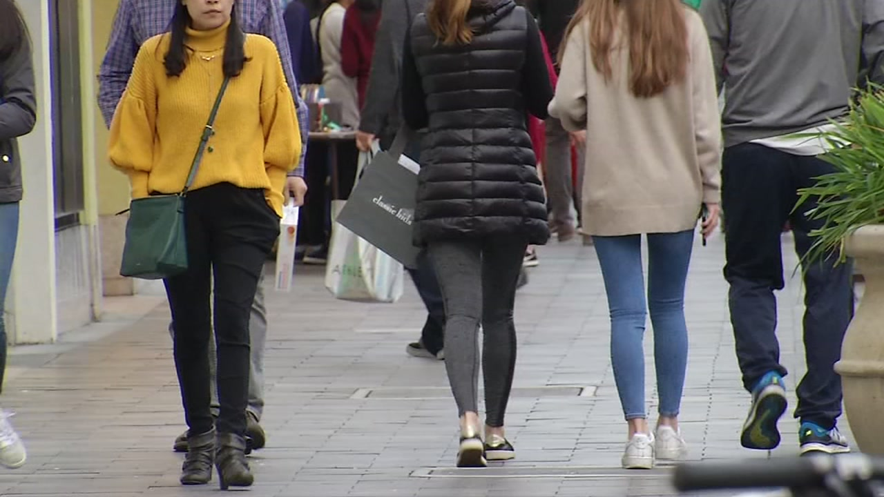 Shoppers hit the streets in San Francisco on Saturday, Dec. 22, 2018.