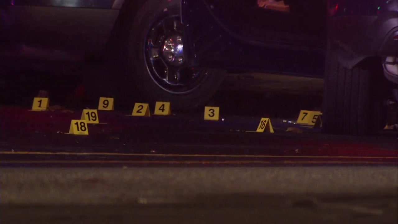 Evidence markers mark shell casing at crime scene in San Jose. Dec. 25, 2018.