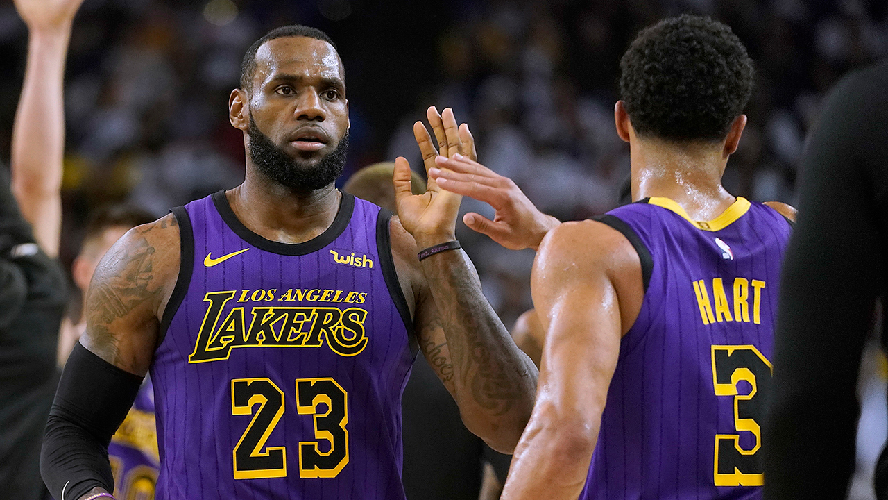 LA Lakers forward LeBron James (23) high-fives Josh Hart (3) at the end of the first half of the game against the Golden State Warriors, Dec. 25, 2018, in Oakland, Calif.