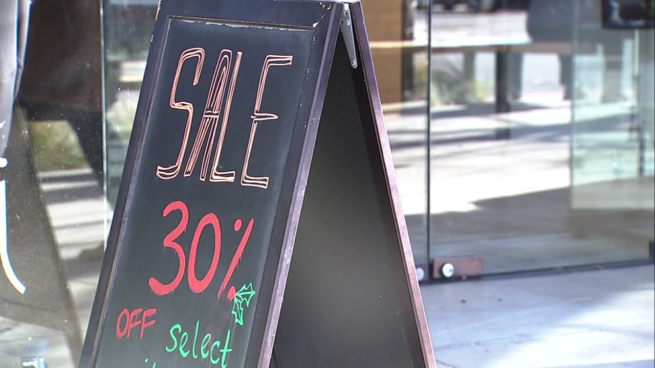A discount sign is seen outside a store in Berkeley, Calif. on Wednesday, Dec. 26, 2018.