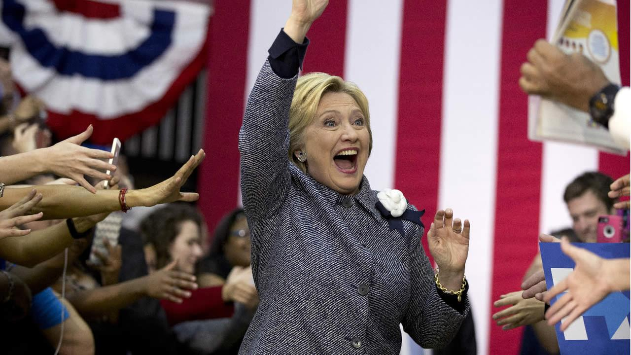 Democratic presidential candidate Hillary Clinton arrives to a cheering crowd at the Grady Cole Center in Charlotte, N.C., Monday, March 14, 2016. (AP Photo/Carolyn Kaster)