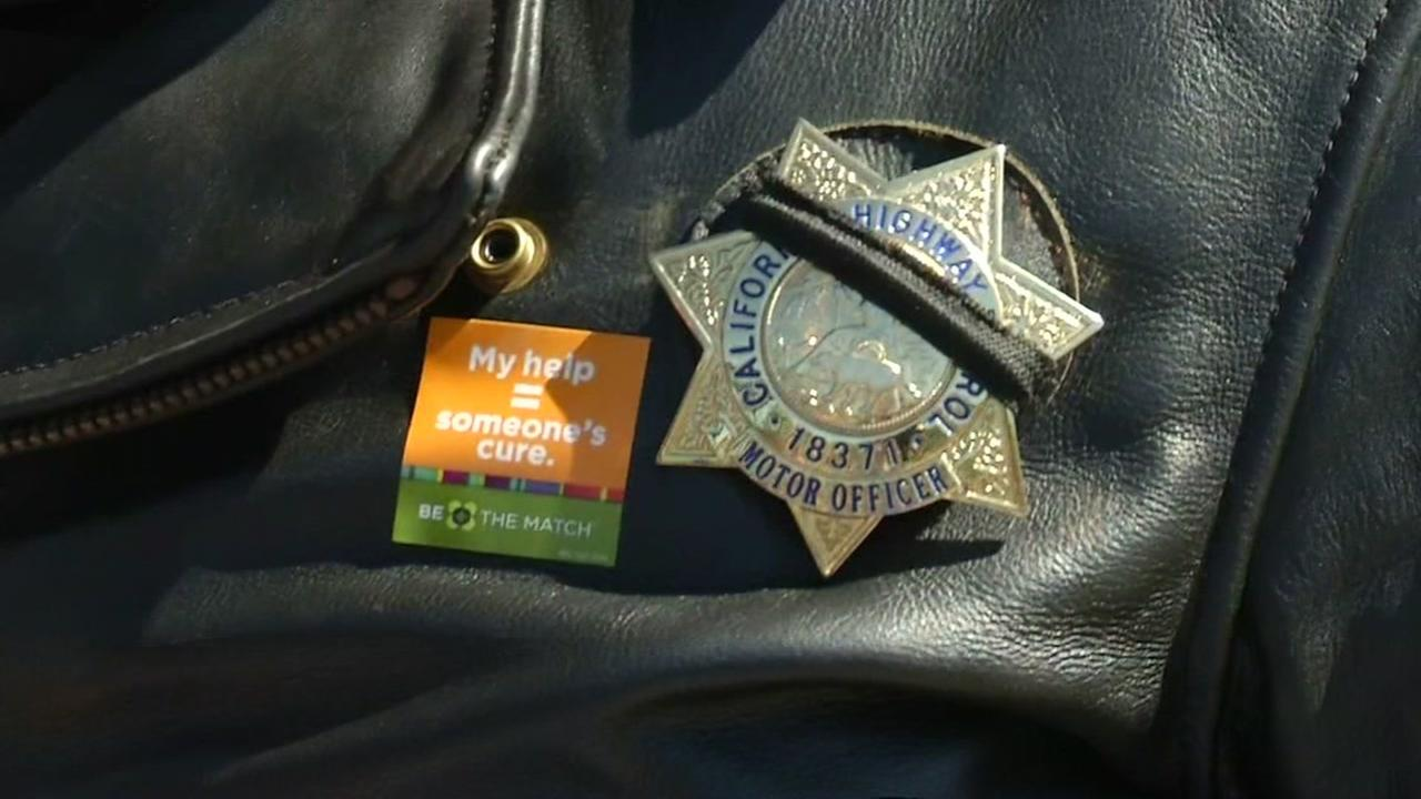 This image shows a Be the Match sticker on a CHP officers jacket during a bone marrow drive in Martinez, Calif. on Wednesday, March 16, 2016.