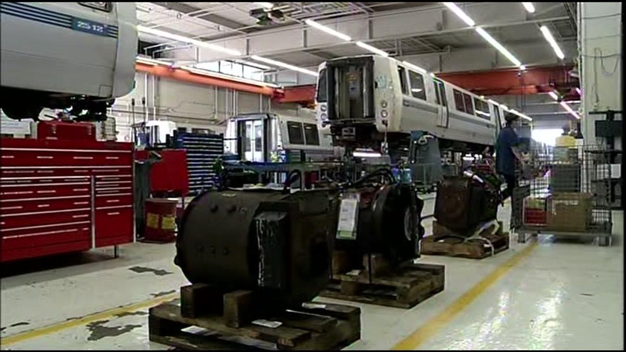 BART trains are looked over by engineers in Concord, Calif. on Thursday, March 17, 2016.