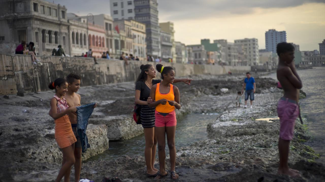 Youths spend the afternoon at Havanas Malecon, in Cuba, Friday, March 18, 2016. U.S. President Barack Obama will travel to the communist island March 20.