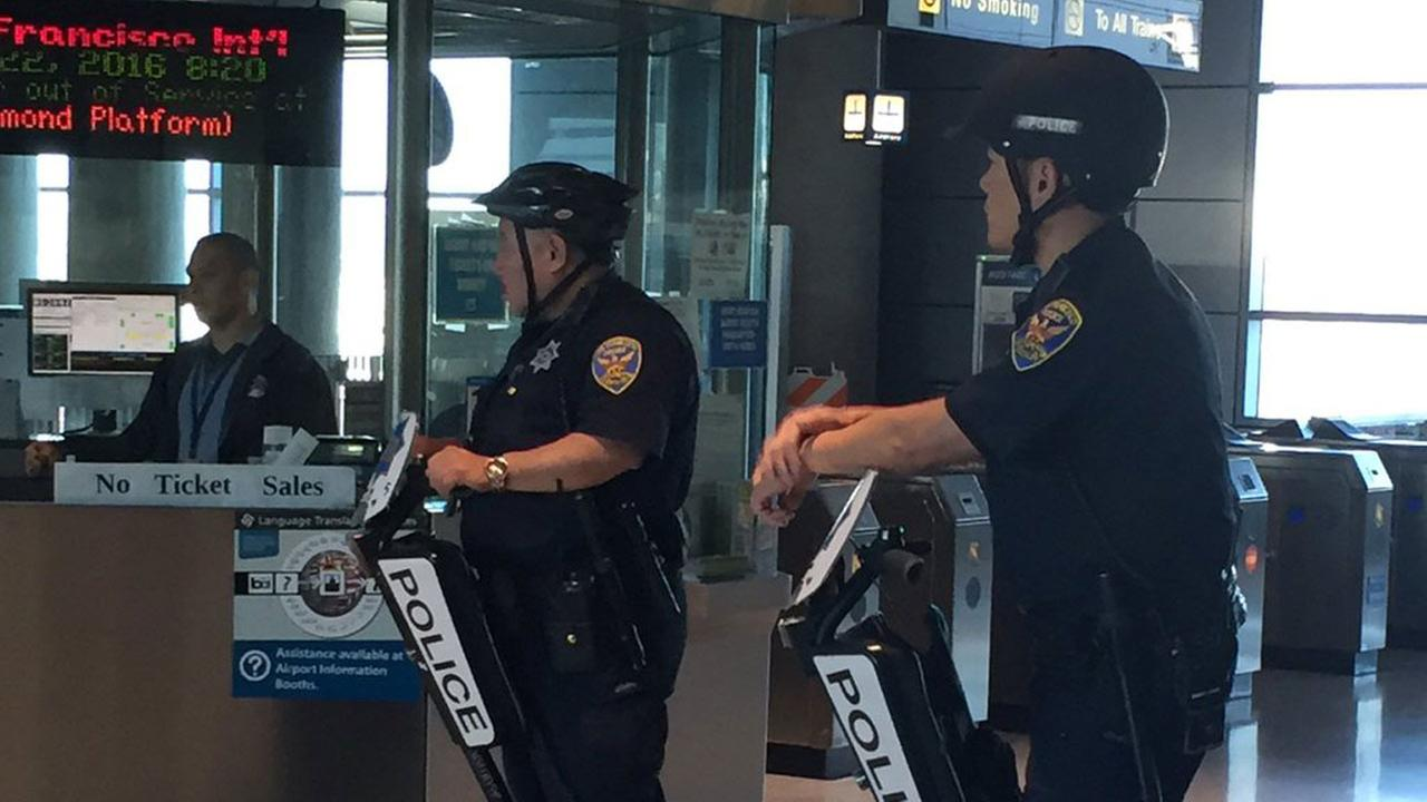 San Francisco police monitor BART station at San Francisco International Airport, Tuesday, March 22, 2016.