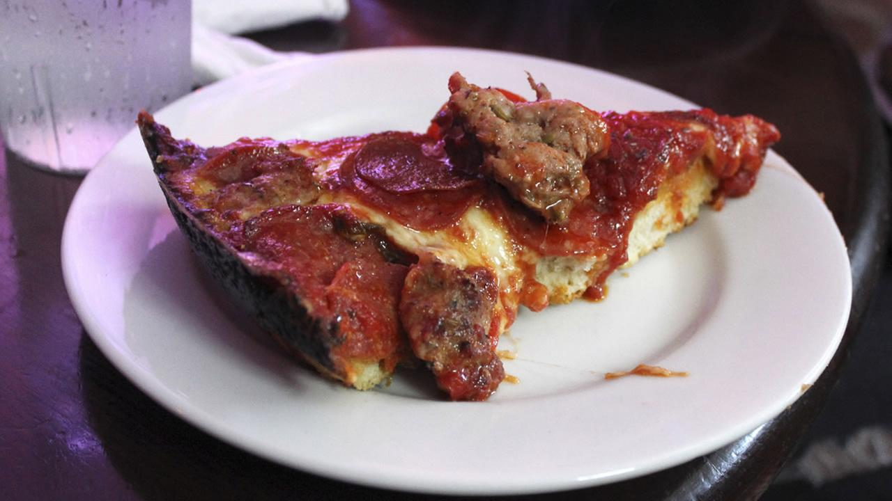 In this Sept. 5, 20143 photo, a slice of deep-dish pizza is shown at Pequods in Chicago.