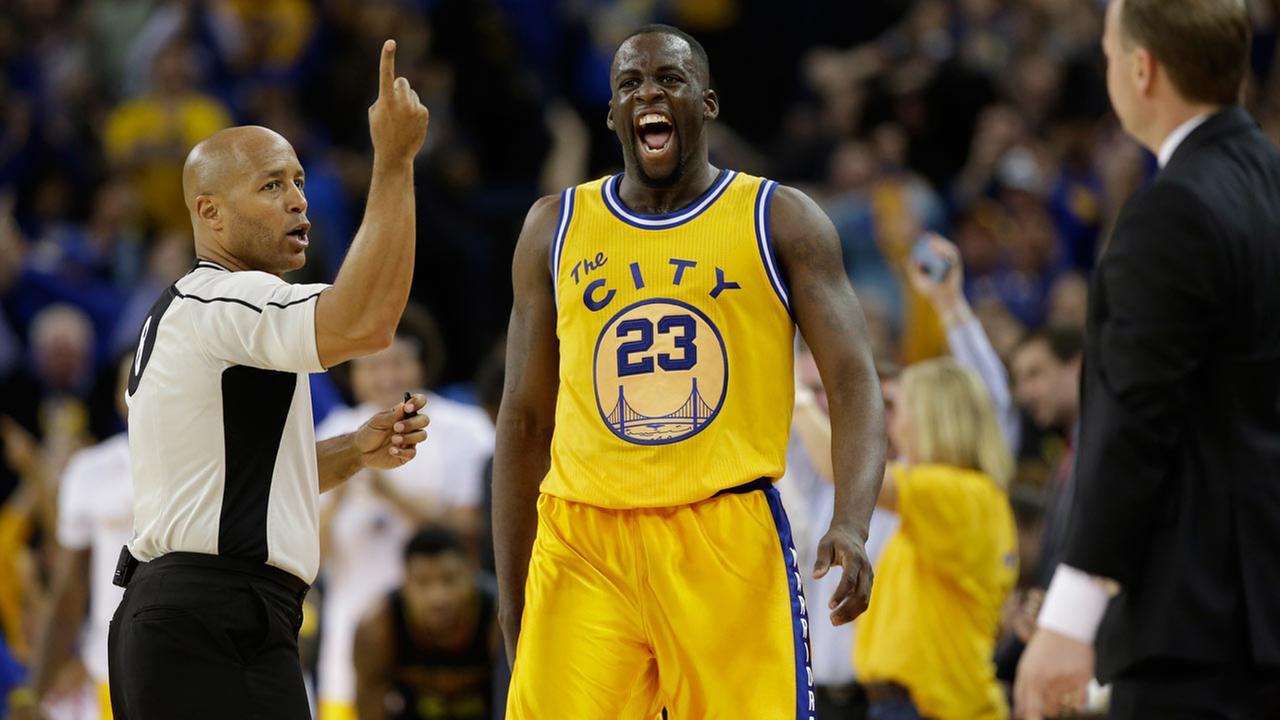 Golden State Warriors Draymond Green (23) celebrates after scoring against the Atlanta Hawks during an NBA basketball game Tuesday, March 1, 2016, in Oakland, Calif.