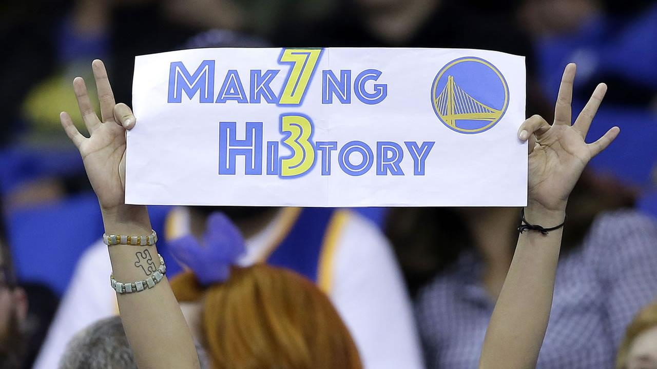 A Golden State Warriors fan holds up a sign during the first half of an NBA basketball game between the Warriors and the Memphis Grizzlies in Oakland, Calif., April 13, 2016.