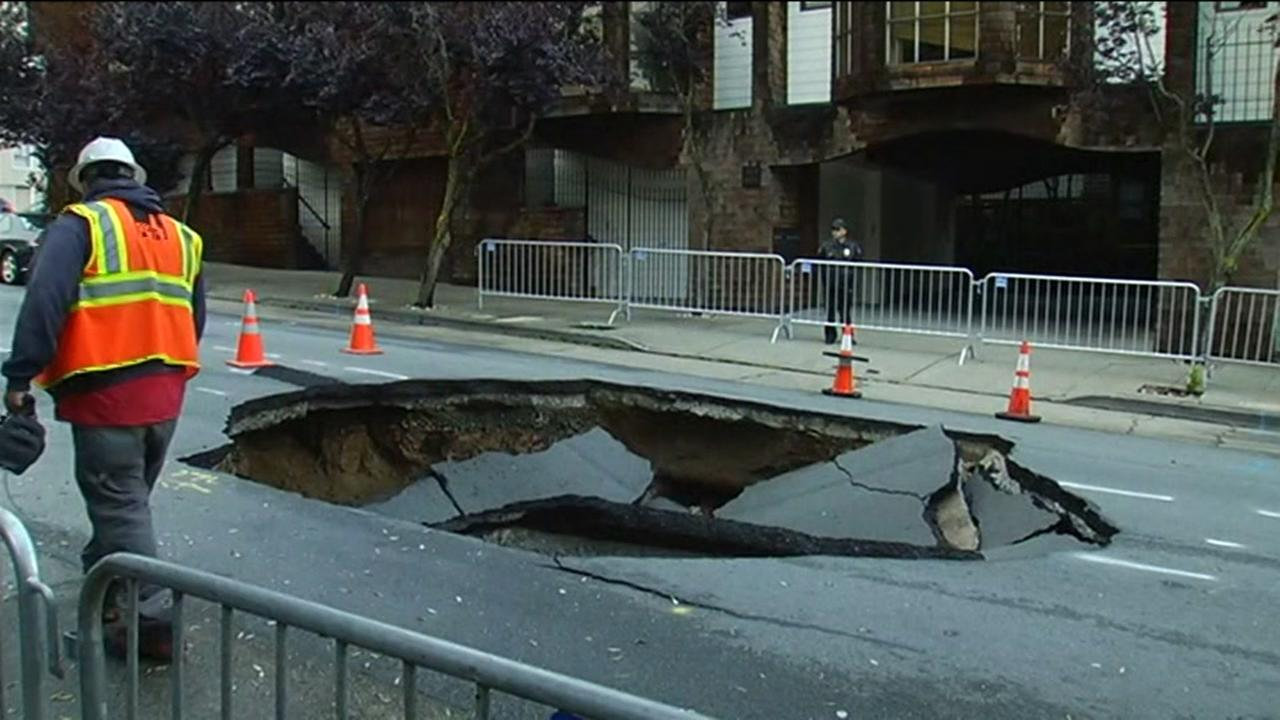 Repairs are underway in San Francisco to fill in a giant sinkhole in the citys Presidio Heights neighborhood on Friday, April 22, 2016.