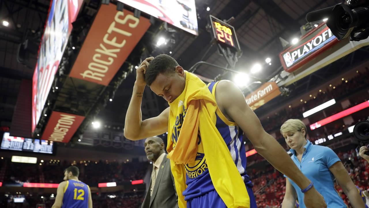 Golden State Warriors Stephen Curry heads off the court and to the locker room at the start of the second half in Game 4 of a first-round NBA basketball playoff series against the Houston Rockets, Sunday, April 24, 2016, in Houston.