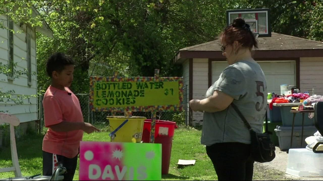 This image from April 2016 shows 9-year-old Tristan Jacobson selling lemonade to help pay for his own adoption in Springfield, Missouri.