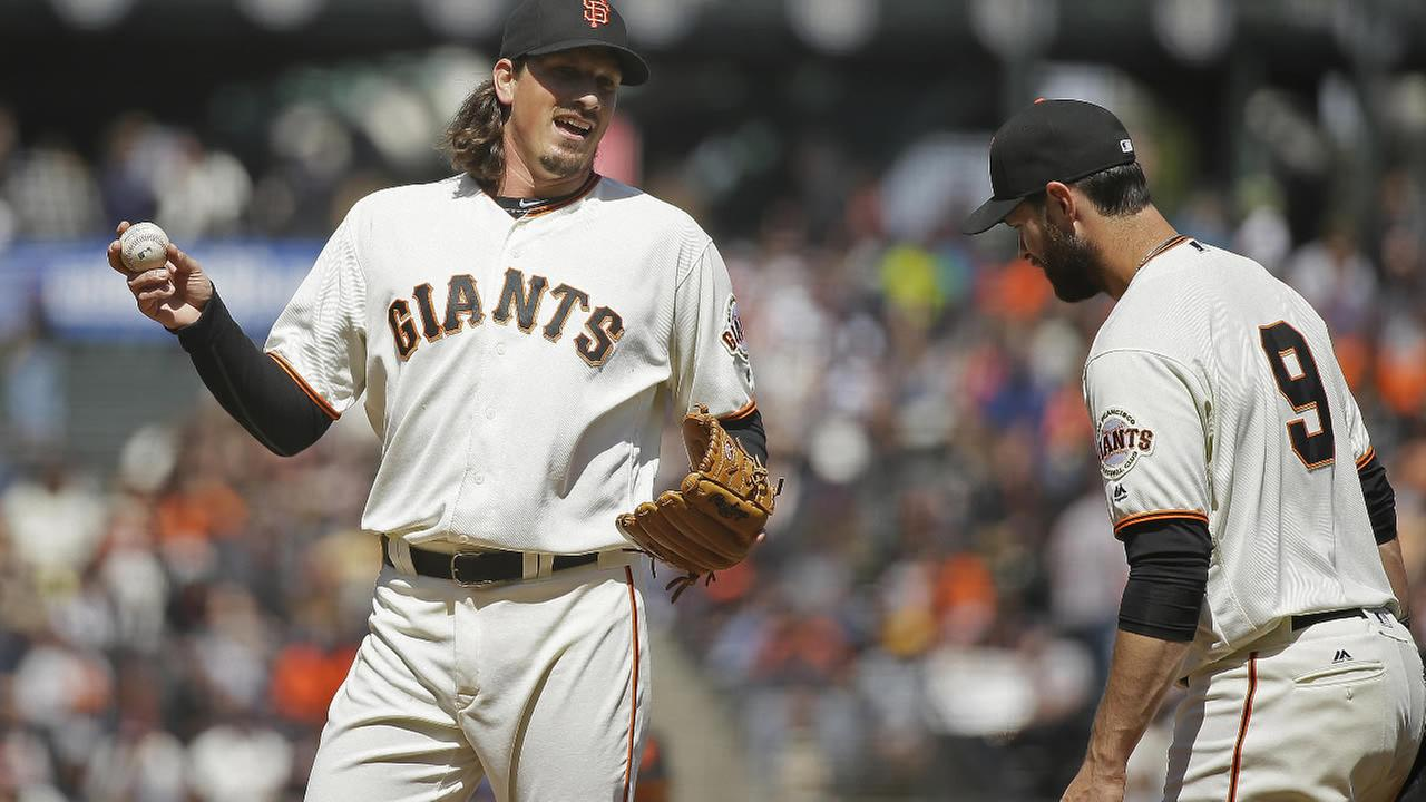 Giants Jeff Samardzija laughs with Brandon Belt during a baseball game against the Padres in San Francisco on Wednesday, April 27, 2016. (AP Photo/Eric Risberg)