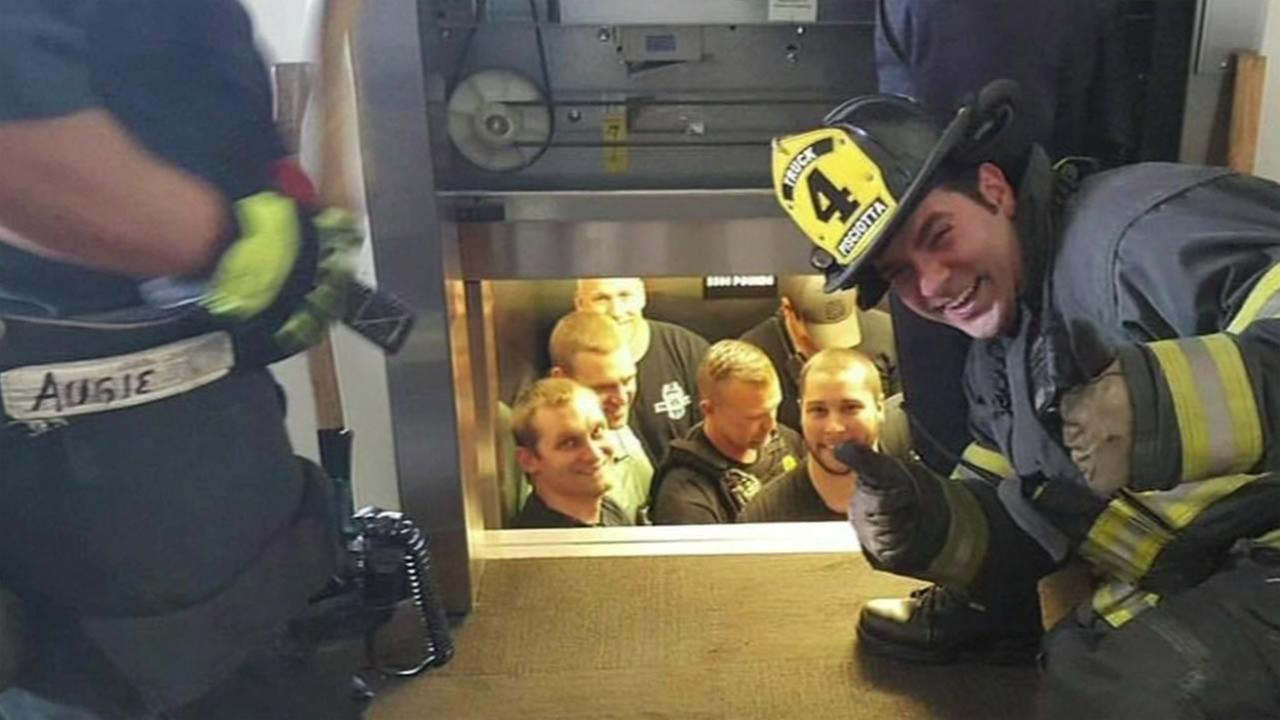 The Kansas City Fire Department had to rescue officers trapped in an elevator and tweeted out a picture to prove it.