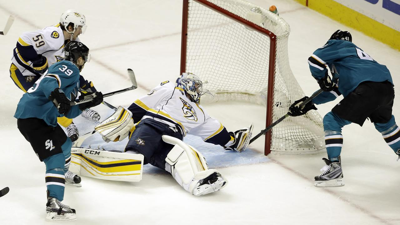 San Jose Sharks Joel Ward, right, scores past Nashville Predators goalie Pekka Rinne during the third period of Game 1 in an NHL hockey Stanley Cup Western Conference semifinal.
